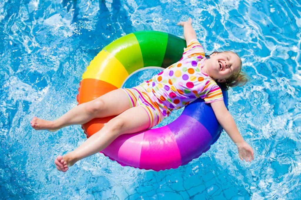 Kids in side swiming pool